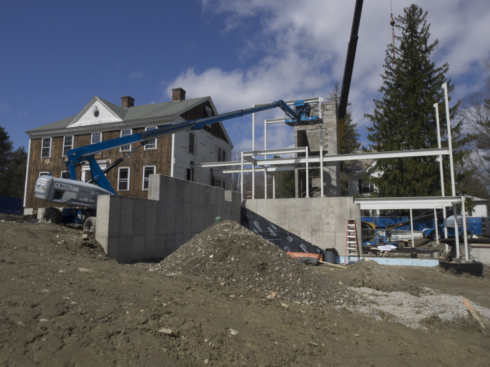 Historic Kellogg House and the beginnings of the new side of the building - Photo by  Nicholas Whitman